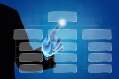 business hand pushing organization chart - stock photo