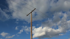 Utility pole with time lapse clouds. Stock Footage