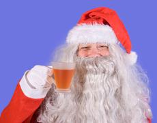 Santa claus holding a teacup Stock Photos