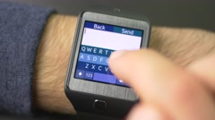 4K Typing Text Message On Smartwatch Screen Stock Footage
