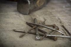 old rusty nails on wooden background - stock photo