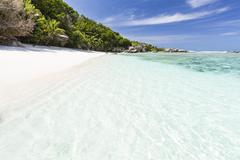 Perfect white beach anse pierrot near source d'argent in la digue, seychelles Stock Photos