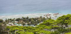 view from the highest point of la digue, nid d'aigle down to the coast - stock photo