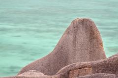 long exposure view of a granite rock at the famous anse source d'argent in la - stock photo