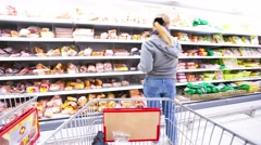 4k timelapse, shopping in Auchan hypermarket - stock footage