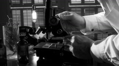 Vintage scientist working with a microscope BW 4k Stock Footage