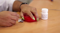 Mexico, 2014: CLOSE UP-HANDHELD. Some pills being spread in a table. Stock Footage