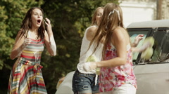 Slow motion medium shot of people having water fight / Pleasant Grove, Utah, - stock footage