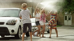 Slow motion medium shot of people having water fight / Pleasant Grove, Utah, Stock Footage