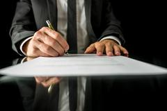 Signing legal papers Stock Photos