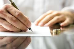 signing  divorce papers - stock photo
