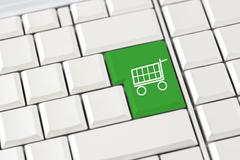 Shopping trolley icon on a computer keyboard Stock Photos
