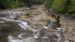Dam release surging down river bed Stock Footage