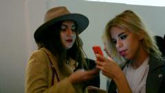 Young females communicate during Ukrainian Fashion Week 2014, Kiev, Ukraine, Stock Footage