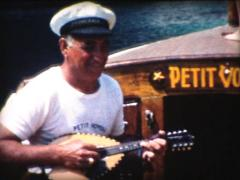 8MM FRANCE sailor playing mandolin Stock Footage