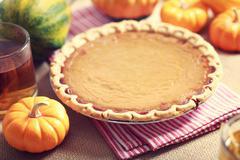 pumpkin pie with small pumpkins - stock photo