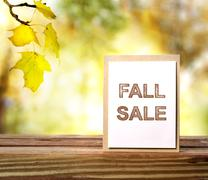 Fall sale sign over yellow leaves background Stock Photos
