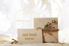 get well soon hand crafted card and present box - stock photo