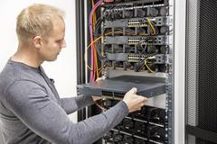 IT consultant build network racks in datacenter Stock Photos