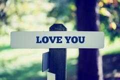 Love you signpost Stock Photos