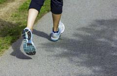 runner - running shoes closeup on runners shoes feet running on road fitness - stock photo