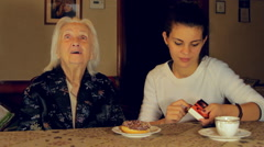 Great Great Grandmother Blowing The Candle For Her Birthday, Side Shot Stock Footage