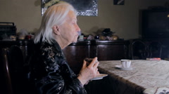 99 Years Old Woman Eating A Doughnut And Drinking Coffee Stock Footage