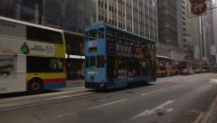 Hong Kong colorful tram shopping district China Stock Footage