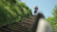 Man Jogging Up Stairs Stock Footage