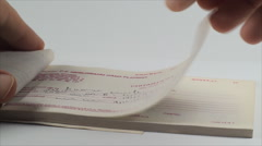 Hand Tearing Receipt From A Receipt Book, Isolated On White, Point Of View Shot - stock footage