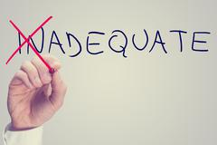 concept of inadequate versus adequate - stock photo