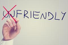 changing the word unfriendly into friendly - stock photo