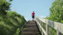 Man walking up some stairs. Stock Footage