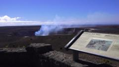 Kilauea, placard and smoking crater Stock Footage