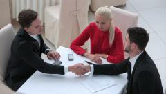 Business meeting and handshake - stock footage