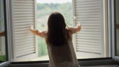 Girl opens the window in the morning, slow motion HD - stock footage