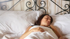 Young woman sleeping on the white linen in bed at home HD Stock Footage