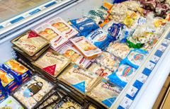 Showcase with frozen products in supermarket Kuvituskuvat