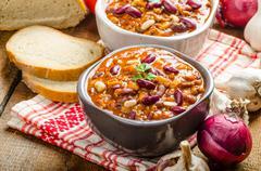 homemade chilli con carne, bio bread - stock photo
