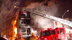 Blazing fire destroyed a building : firefighter need code red for evacuated crew - stock footage