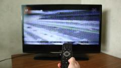 Switching Channels on TV Stock Footage