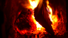 Fire place - closeup bright blaze flare and firewood Stock Footage