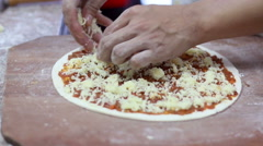 HD close up hand of chef perparing pizza in kitchen, zoom in Stock Footage