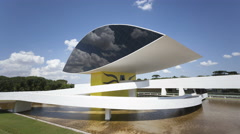 Stock Video Footage of 4K Time lapse Niemeyer Museum Curitiba zoom in