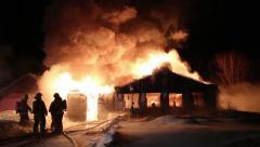 Intense fire destroys a little house in winter Stock Footage