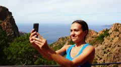 Young woman take a selfie photo by the sea HD Stock Footage