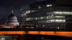 Double-decker buses on London Bridge in London at night Stock Footage