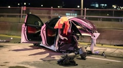 Car cut in half after crashing:  2 dead one by ejection Stock Footage