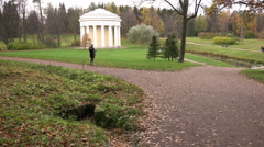 People walking in autumn park of culture and recreation Stock Footage