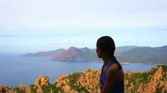 Young female tourist enjoying beautiful view, Corsica, Les calanches HD Stock Footage
